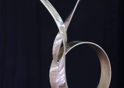 "<em>Circle of Love Gene</em>, stainless steel, 70"" x 12"" x 16"""